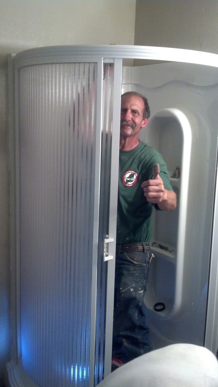 Lee gives us the thumbs up and all is well, as the shower enclosure is installed.