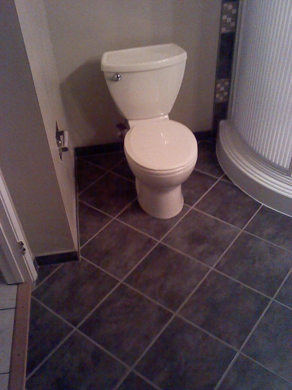 Tile work is finished and toilet installed.