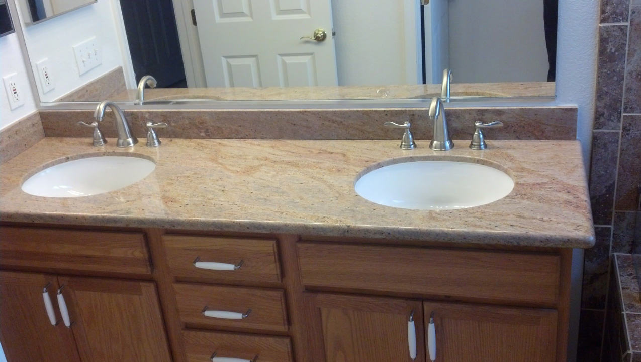 The final portion. Granite countertops, undermount sinks, component faucets, and lights are installed.