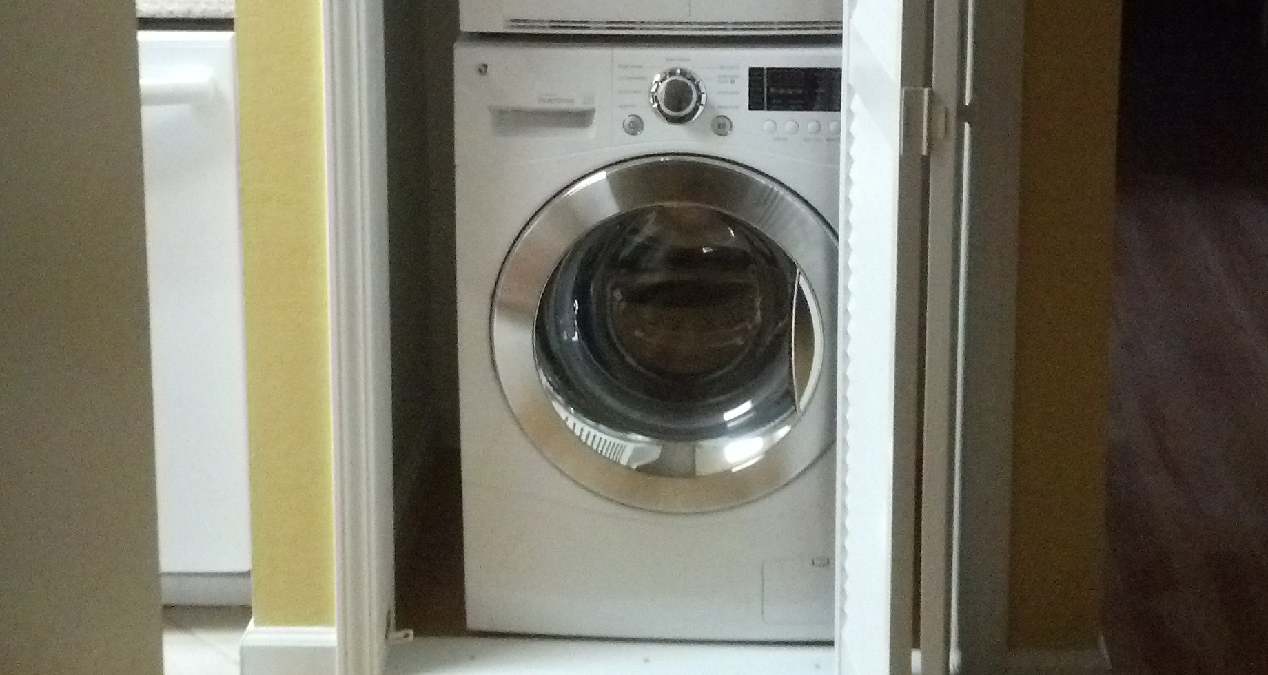 A fully functional, aesthetically pleasing, washer / dryer closet.