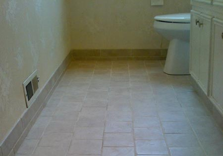 Grout is applied and the floor is sealed.